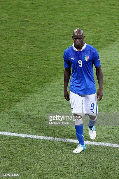 Mario Balotelli of Italy shows his dejection after defeat during the UEFA EURO 2012 final match between Spain and Italy at the Olympic Stadium on...