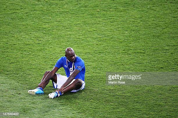 Mario Balotelli of Italy shows his dejection after the UEFA EURO 2012 final match between Spain and Italy at the Olympic Stadium on July 1 2012 in...