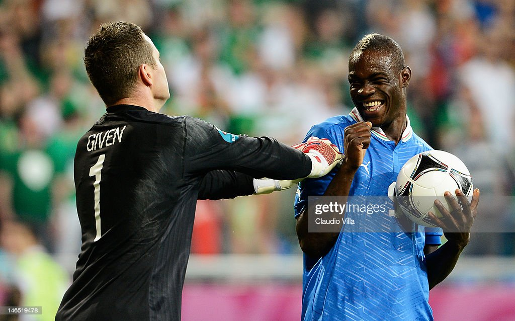Mario Balotelli of Italy smiles at Shay Given of Republic of Ireland during the UEFA EURO 2012 group C match between Italy and Ireland at The Municipal Stadium on June 18, 2012 in Poznan, Poland.
