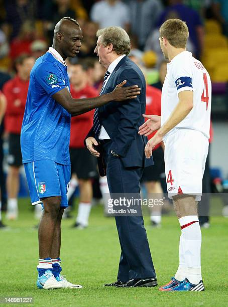 Mario Balotelli of Italy speaks with England manager Roy Hodgson after the penalty shoot out during the UEFA EURO 2012 quarter final match between...