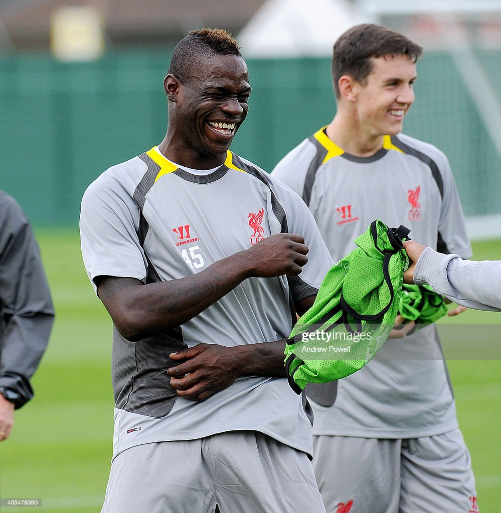 Mario Balotelli of Liverpool all smilies during a training session at Melwood Training ground on September 15, 2014 in Liverpool, England.