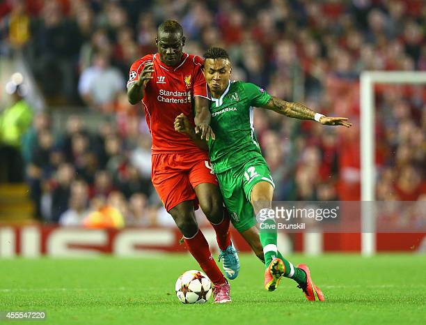Mario Balotelli of Liverpool and Anicet Abel of PFC Ludogorets Razgrad tussle for the ball during the UEFA Champions League Group B match between...