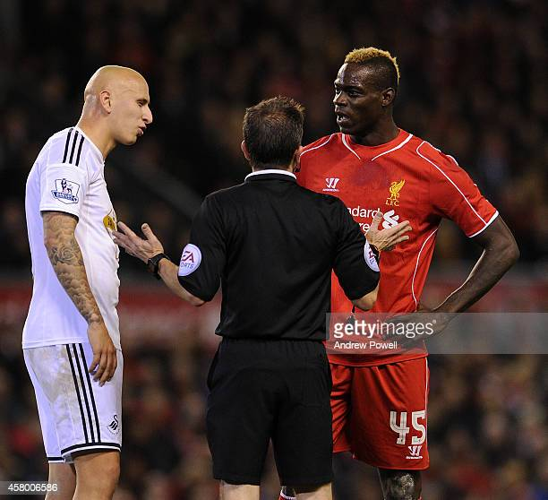 Mario Balotelli of Liverpool and Jonjo Shelvey of Swansea City clash during the Capital One Cup Fourth Round match between Liverpool and Swansea City...