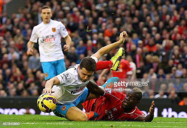 Mario Balotelli of Liverpool appeals for a penalty wgich is turned down after clashing with Alex Bruce of Hull City during the Barclays Premier...