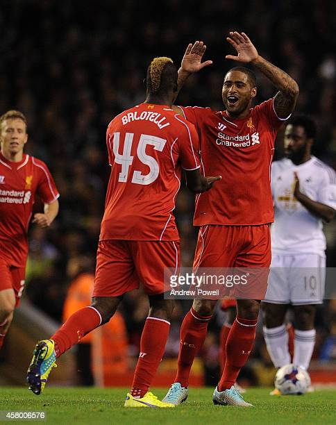 Mario Balotelli of Liverpool celebrates his goal during the Capital One Cup Fourth Round match between Liverpool and Swansea City at Anfield on...