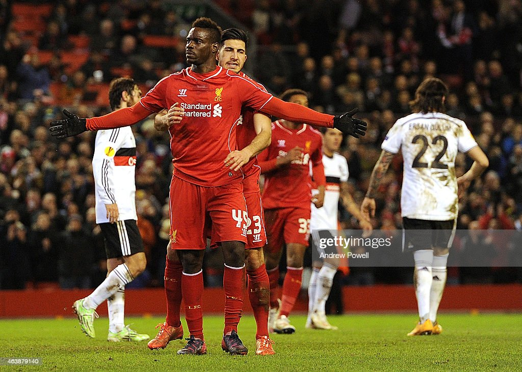 Mario Balotelli of Liverpool celebrates his goal with Emre Can during the UEFA Europa League Round of 32 match between Liverpool FC and Besiktas JK on February 19, 2015 in Liverpool, United Kingdom.