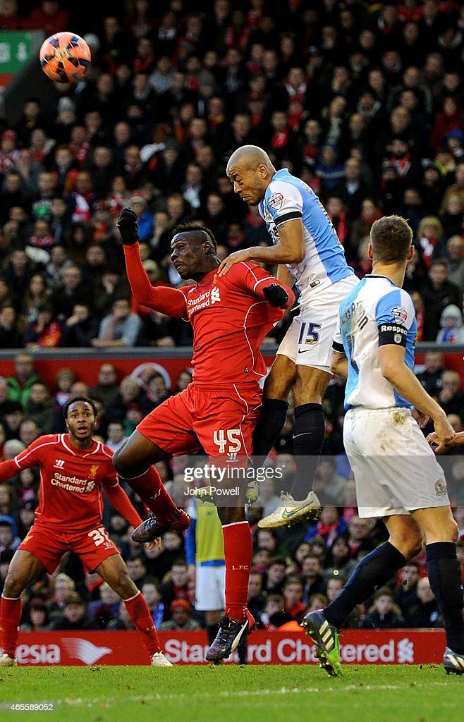 Mario Balotelli of Liverpool competes with Alex Baptiste of Blackburn Rovers during the FA Cup Quarter Final match between Liverpool and Blackburn Rovers at Anfield on March 8, 2015 in Liverpool, England.
