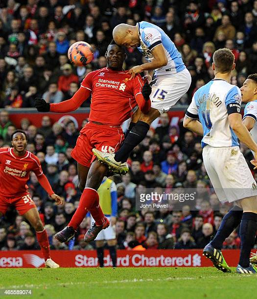 Mario Balotelli of Liverpool competes with Alex Baptiste of Blackburn Rovers during the FA Cup Quarter Final match between Liverpool and Blackburn...