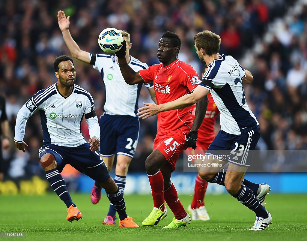 Mario Balotelli of Liverpool is closed down by Joleon Lescott and Gareth McAuley of West Brom during the Barclays Premier League match between West Bromwich Albion and Liverpool at The Hawthorns on April 25, 2015 in West Bromwich, England.