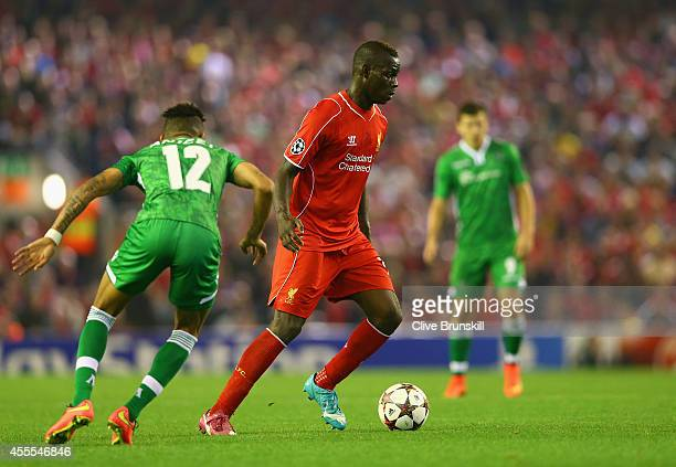 Mario Balotelli of Liverpool is marshalled by Anicet Abel of PFC Ludogorets Razgrad during the UEFA Champions League Group B match between Liverpool...