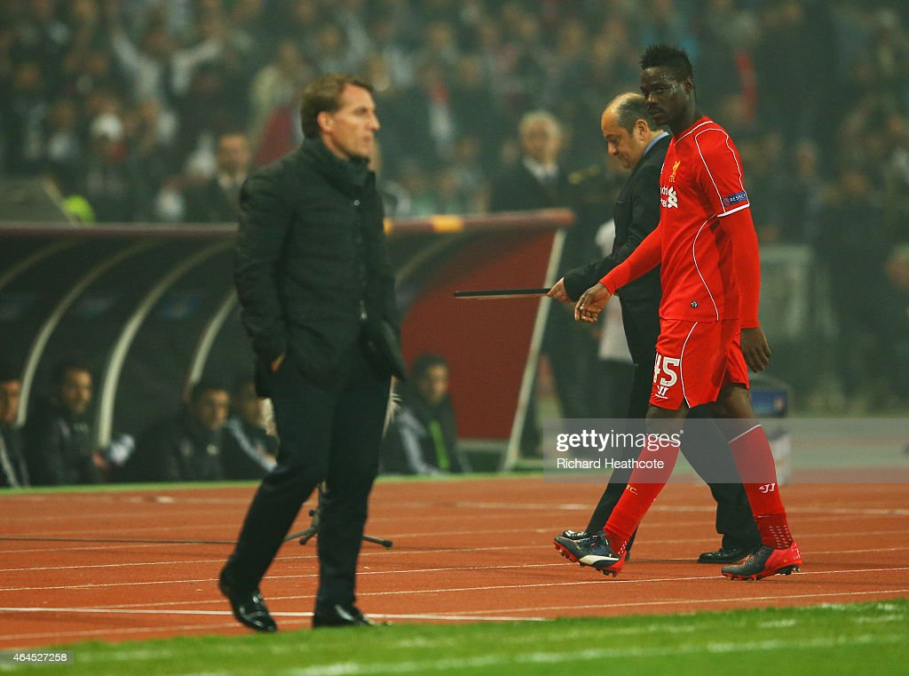 Mario Balotelli of Liverpool looks across as Brendan Rodgers manager of Liverpool as he is substituted during the UEFA Europa League Round of 32 second leg match between Besiktas JK and Liverpool FC on February 26, 2015 in Istanbul, Turkey.
