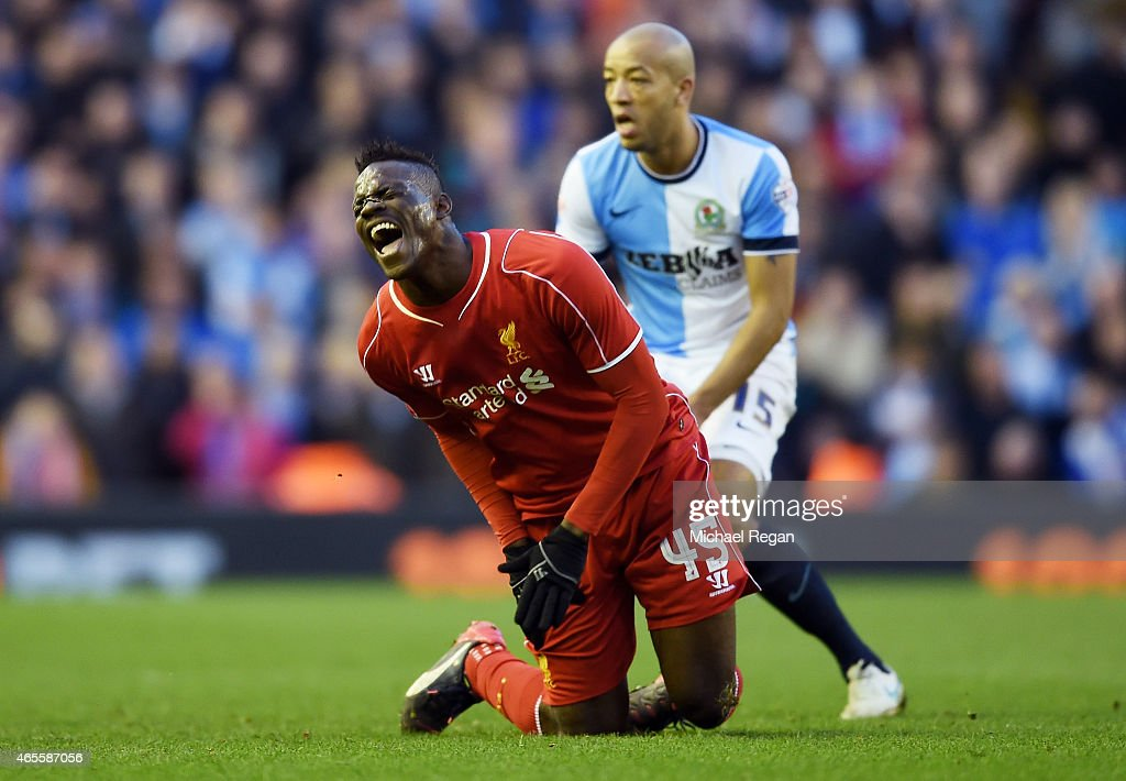 Mario Balotelli of Liverpool reacts after being caught by the studs belonging to Tom Cairney of Blackburn during the FA Cup Quarter Final match between Liverpool and Blackburn Rovers at Anfield on March 8, 2015 in Liverpool, England.