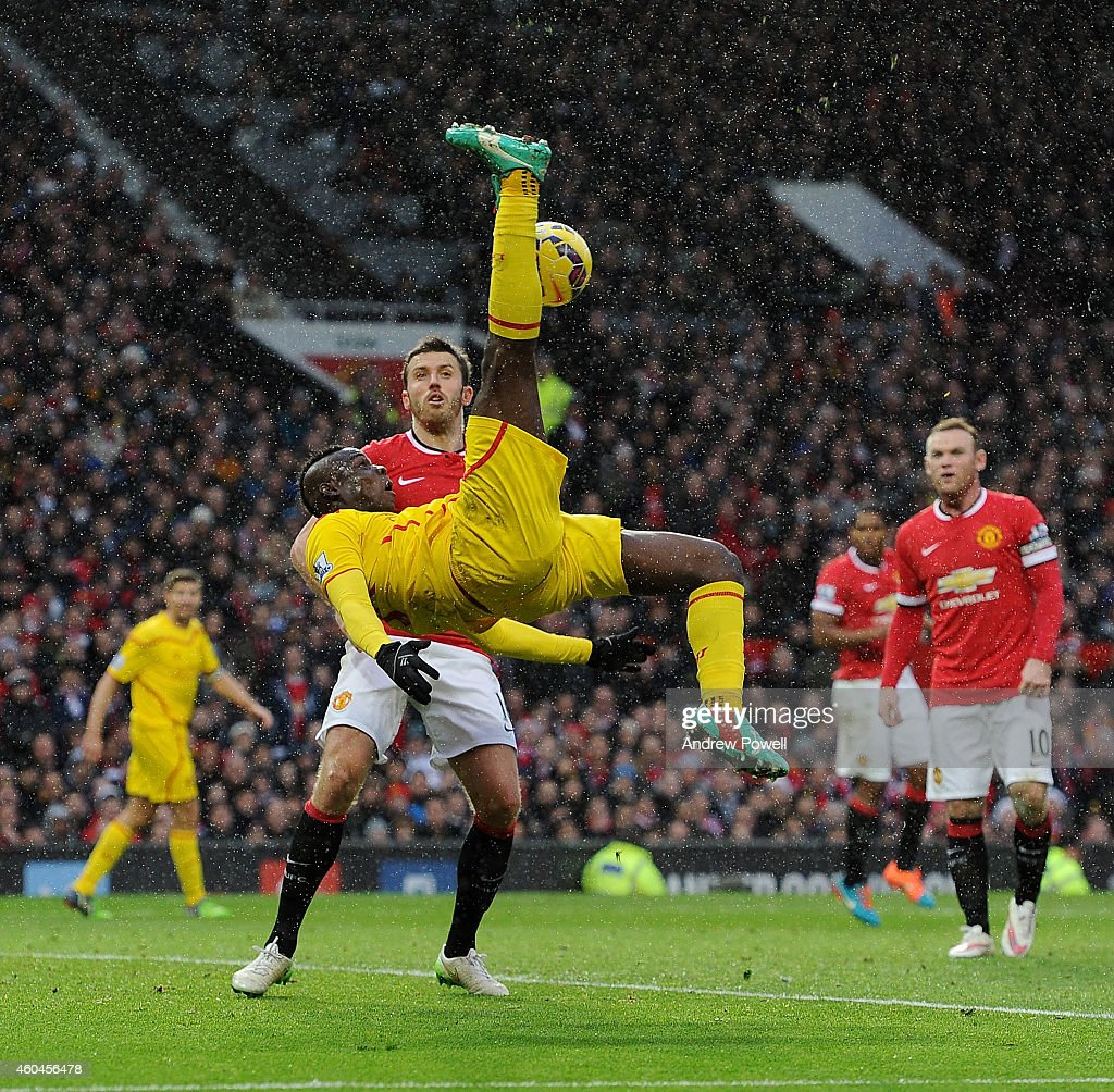 Mario Balotelli of Liverpool tries an over-head kick during the Barclays Premier League match between Manchester United and Liverpool at Old Trafford on December 14, 2014 in Manchester, England.