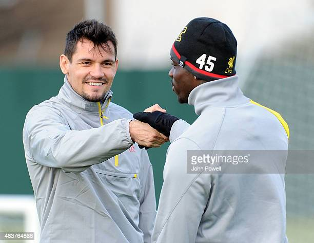 Mario Balotelli of Liverpool with Dejan Lovren of Liverpool during a Training session at Melwood Training ground on February 18 2015 in Liverpool...