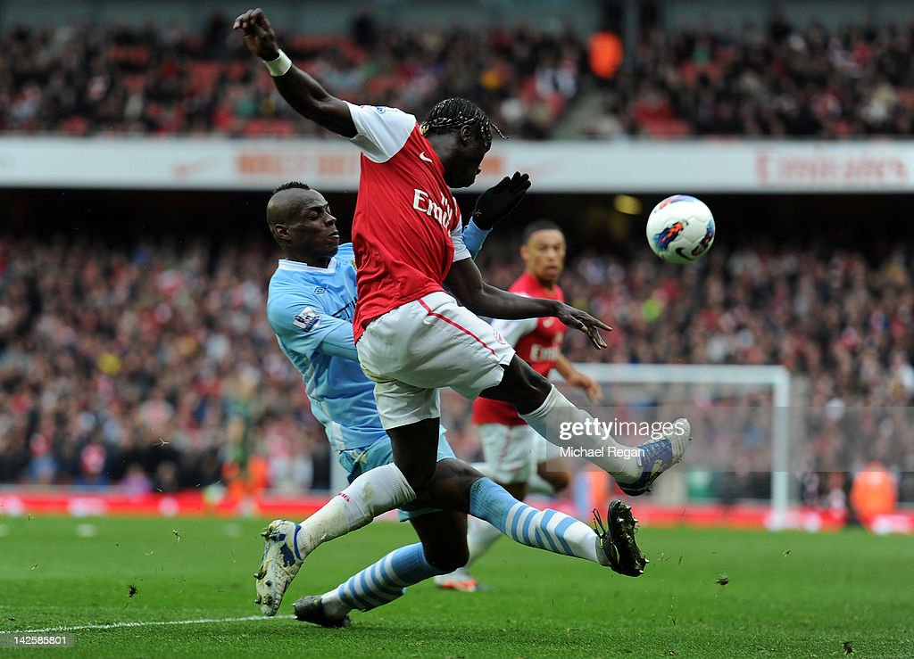 Mario Balotelli of Man City clashes with Bacary Sagna of Arsenal during the Barclays Premier League match between Arsenal and Manchester City at Emirates Stadium on April 8, 2012 in London, England.