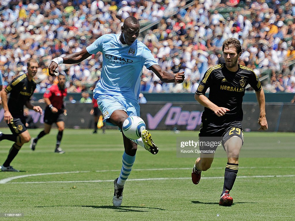 Mario Balotelli #45 of Manchester City attempts a shot on goal against Kyle Davies #29 Los Angeles during the Herbalife World Football Challenge 2011 at the Home Depot Center on July 24, 2011 in Carson, California.