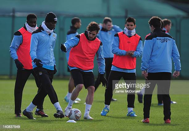 Mario Balotelli of Manchester City battles with Owen Hargreaves during a Manchester City training session at Carrington Training Ground on March 7...