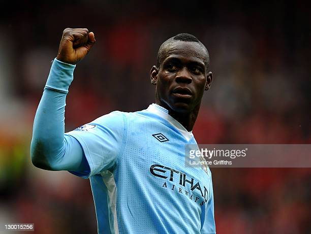 Mario Balotelli of Manchester City celebrates scoring his team's second goal during the Barclays Premier League match between Manchester United and...