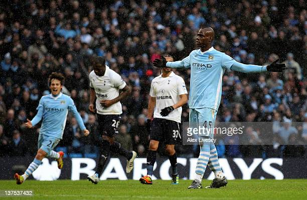 Mario Balotelli of Manchester City celebrates scoring his team's third goal from a penalty during the Barclays Premier League match between...