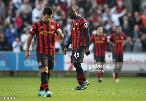 Mario Balotelli of Manchester City is dejected after Luke Moore of Swansea City scores during the Barclays Premier League match between Swansea City...