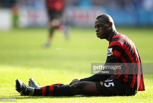 Mario Balotelli of Manchester City reacts after he does not win a foul during the Barclays Premier League match between Swansea City and Manchester...