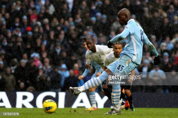 Mario Balotelli of Manchester City scores his team's third goal from a penalty during the Barclays Premier League match between Manchester City and...
