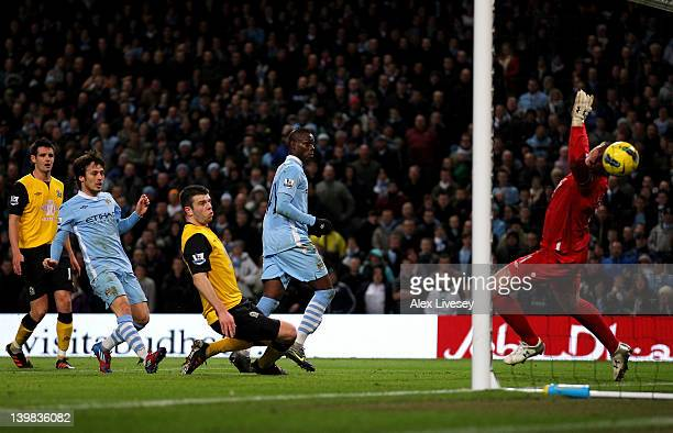 Mario Balotelli of Manchester City scores the opening goal during the Barclays Premier League match between Manchester City and Blackburn Rovers at...