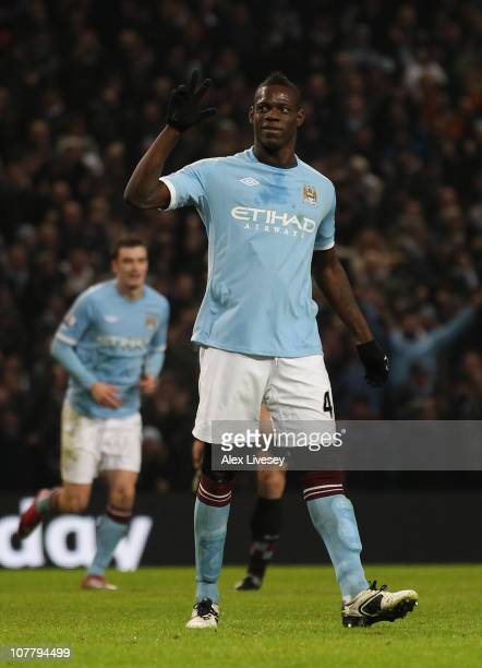 Mario Balotelli of Manchester City shows three fingers as he celebrates after scoring his third goal during the Barclays Premier League match between...