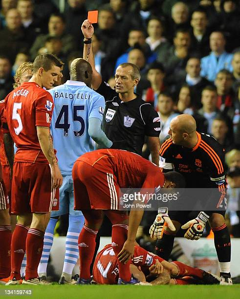 Mario Balotelli of Manchestetr City gets a red card during the Barclays Premier League match between Liverpool and Manchester City at Anfield on...