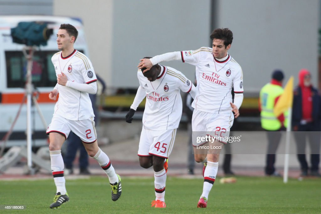 Mario Balotelli (C) of Milan celebrates with team-mate Kaka (R) after scoring their first goal during the Serie A match between Cagliari Calcio and AC Milan at Stadio Sant'Elia on January 26, 2014 in Cagliari, Italy.
