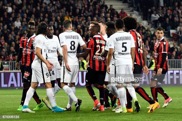 Mario Balotelli of Nice and Edinson Cavani of PSG during the French Ligue 1 match between Nice and Paris Saint Germain at Allianz Riviera on April 30...