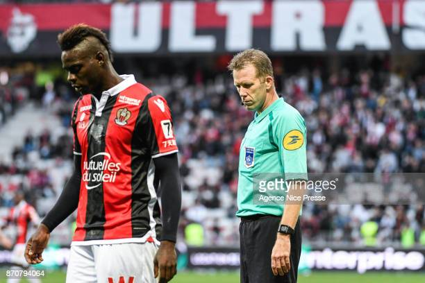 Mario Balotelli of Nice and the referee Olivier Thual during the Ligue 1 match between OGC Nice and Dijon FCO at Allianz Riviera on November 5 2017...