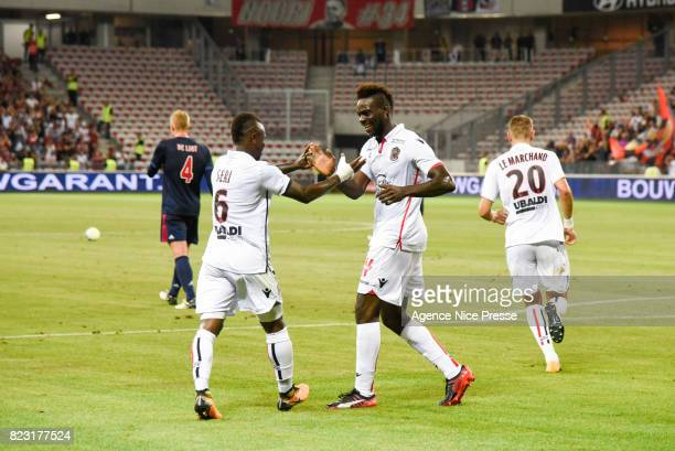 Mario Balotelli of Nice celebrates his goal with Jean Michael Seri of Nice during the UEFA Champions League Qualifying match between Nice and Ajax...