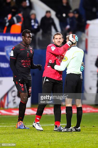 Mario Balotelli of Nice Jean Louis Leca of Bastia and Clement Turpin referee during the French Ligue 1 match between Bastia and Nice at Stade Armand...
