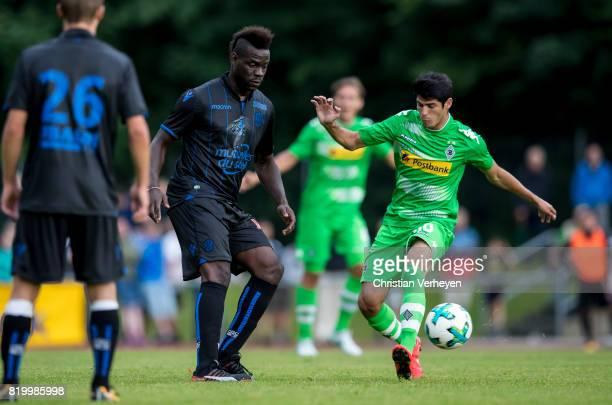Mario Balotelli of OGC Nice and Julio Villalba of Borussia Moenchengladbach battle for the ball during a friendly match between Borussia...