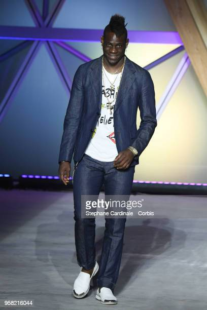 Mario Balotelli walks the runway at Fashion For Relief Cannes 2018 during the 71st annual Cannes Film Festival at Aeroport Cannes Mandelieu on May 13...