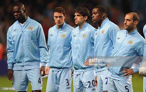 Mario Balotelli Wayne Bridge Owen Hargreaves Nedum Onuoha and Pablo Zabaleta of Manchester City look on before the Carling Cup Third Round match...