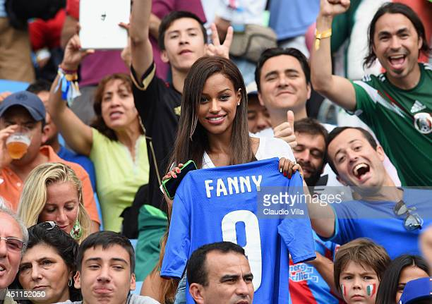 Mario Balotelli's girlfriend Fanny Neguesha holds a Italy jersey prior to the 2014 FIFA World Cup Brazil Group D match between Italy and Uruguay at...