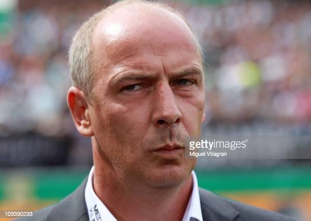 Mario Basler, head coach of Wacker Burghausen, looks on during the DFB Cup first round match between Wacker Burghausen and Borussia Dortmund at...