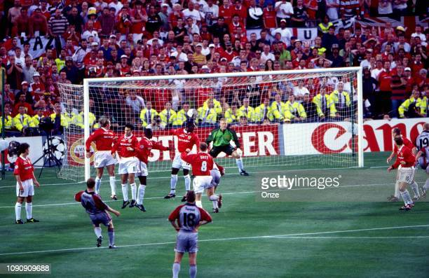 Mario Basler of Bayern Munich scores a goal at Peter Schmeichel of Manchester United during the UEFA Champions league final match between Manchester...