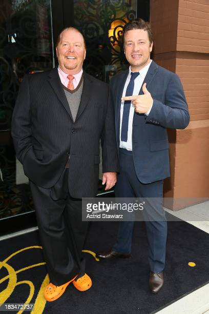 Mario Batali and Jamie Oliver attend 2nd Annual Mario Batali Foundation Honors Dinner at Del Posto Ristorante on October 6 2013 in New York City