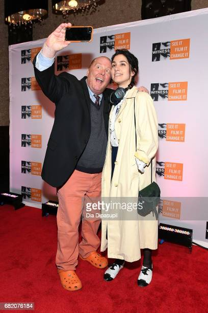 Mario Batali and Nadya Tolokonnikova take a selfie during the WITNESS 25th Anniversary Gala at The Edison Ballroom on May 11 2017 in New York City