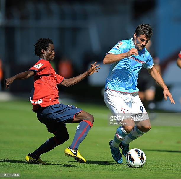Mario Bermejo of RC Celta de Vigo is tackled by Anthony Annan of CA Osasuna during the La Liga match between RC Celta de Vigo and CA Osasuna at...