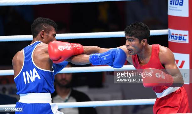 Mario Blasius Kali of Indonesia competes against Thiwanka Samdaruwam Ranasinghe Palleha Muturanwellige of Sri Lanka during their men's light fly 49kg...