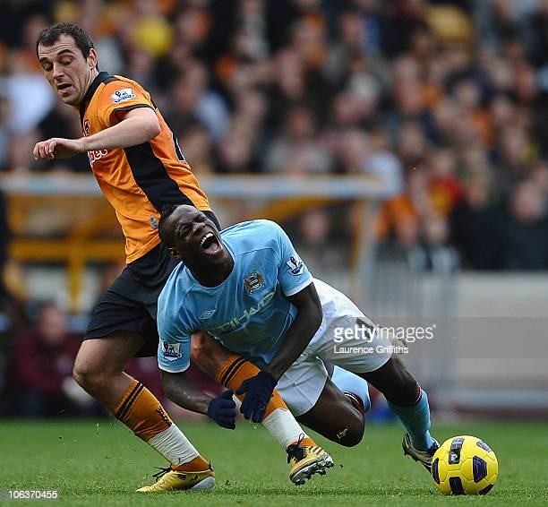 Mario Bolotelli of Manchester City battles with Nenad Milijas of Wolves during the Barclays Premier League match between Wolverhampton Wanderers and...