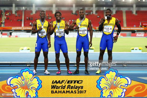 Mario Burke Ramon Gittens Nicholas Deshong and Burkheart Ellis Jr of Barbados celebrate on the pudium after placing second in the Men's 4 x 100...