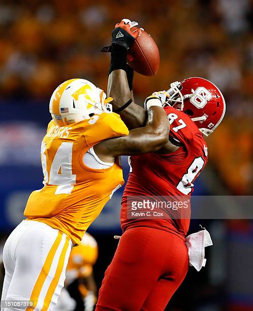Mario Carter of the North Carolina State Wolfpack pulls in this reception against Herman Lathers of the Tennessee Volunteers at Georgia Dome on...