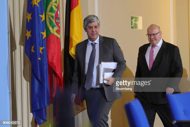 Mario Centeno Portugal's finance minister and head of the group of euroarea finance ministers left and Peter Altmaier Germanys acting finance...