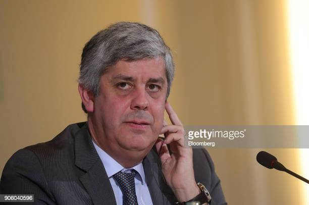 Mario Centeno Portugal's finance minister and head of the group of euroarea finance ministers listens via an earpiece during a news conference at the...
