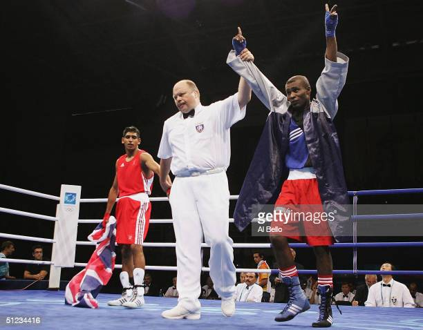 Mario Cesar Kindelan Mesa of Cuba celebrates after his victory against Amir Khan of Great Britain after the men's boxing 60 kg final bout on August...